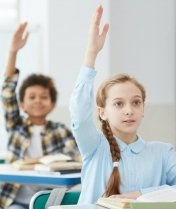 Children Raising Hands in School